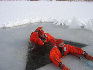 photo of water rescue team training for an ice rescue