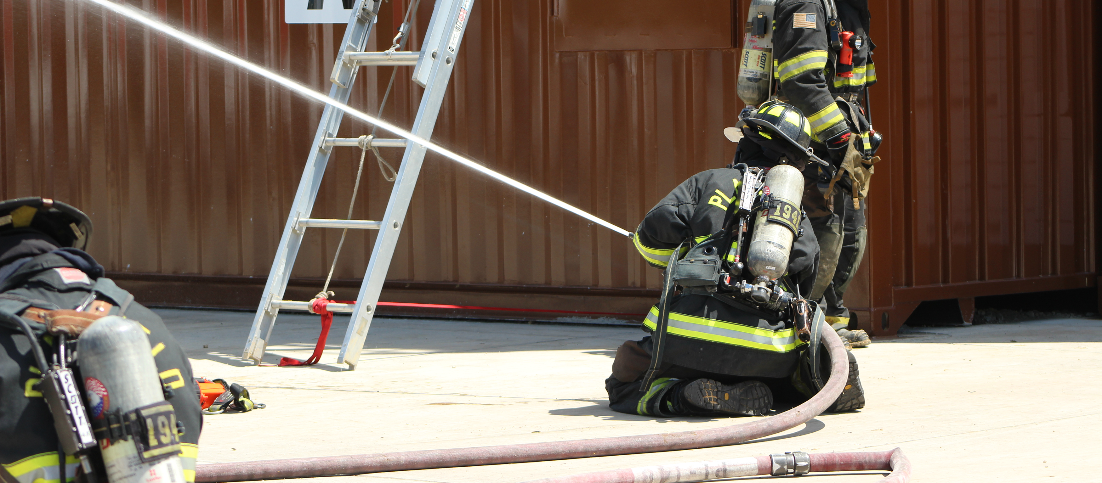 firefighter spraying the fire hose